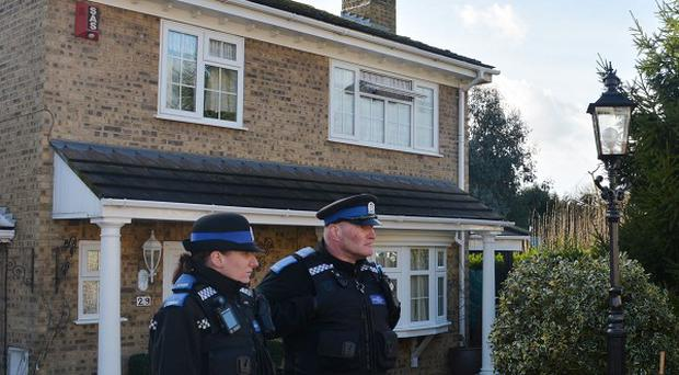 Police Officers and members of the media outside the Hampshire home of Liberal Democrat MP Mike Hancock