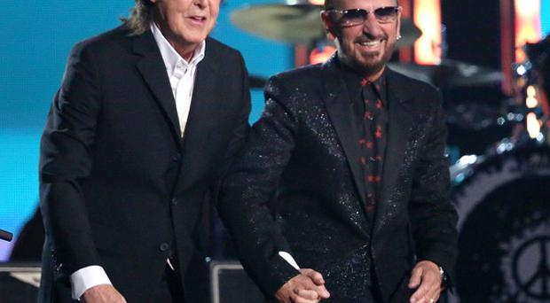 Sir Paul McCartney, left, and Ringo Starr perform on stage at the Grammys (AP)