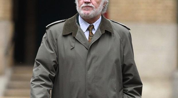 Former DJ Dave Lee Travis arrives at London's Southwark Crown Court, where he is accused of a series of indecent assaults and one sexual assault