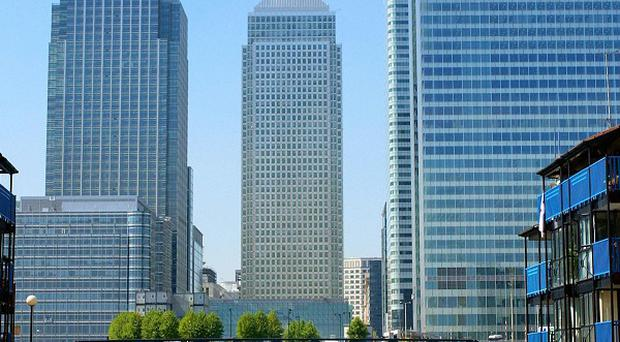A man has died after falling from the JP Morgan bank HQ in London's Canary Wharf