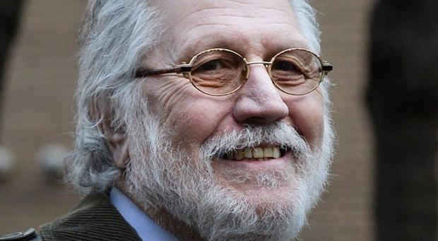 Dave Lee Travis will give evidence for a third day, defending himself against allegations of indecency.