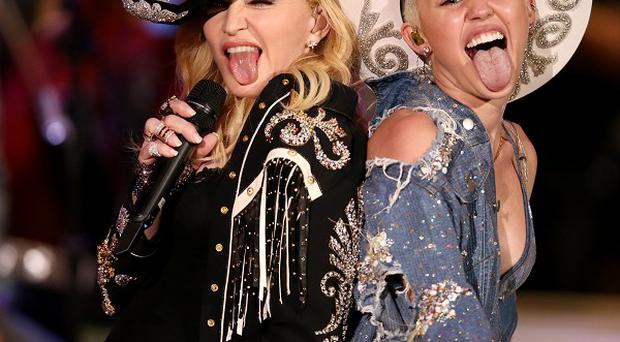 Miley Cyrus performs with Madonna (AP)
