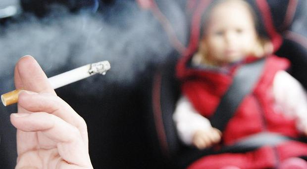 Campaigners claim a ban would protect half-a-million children who were exposed to second-hand smoke in cars every week