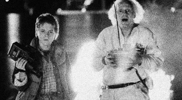 Michael J Fox as Marty McFly and Christopher Lloyd as inventor Doctor Emmett Brown in a scene from the 1985 film Back To The Future (AP)