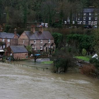 Flooded gardens in Ironbridge, Shropshire, after the river Severn burst its banks