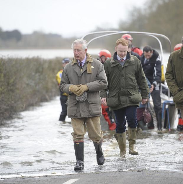 The Prince of Wales steps from a boat after travelling to the community of Muchelney and meeting with a local farming family at Thorney Moor Farm, to see the damage caused by floods
