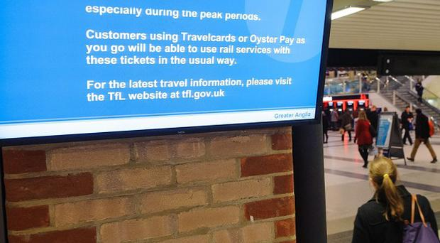Screens display information for passengers at Liverpool Street station at the start of a strike by London Underground staff