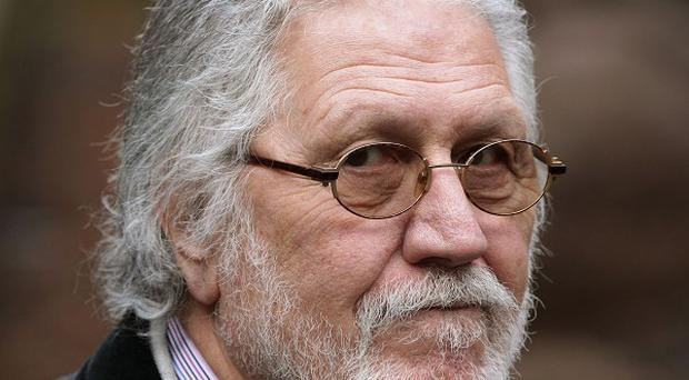 A musician who modelled for former DJ Dave Lee Travis (pictured) said he had been