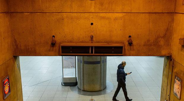 A passenger at Westminster Underground station, in central London, during a 48-hour tube strike as London Underground workers strike over planned job cuts and ticket office closures.
