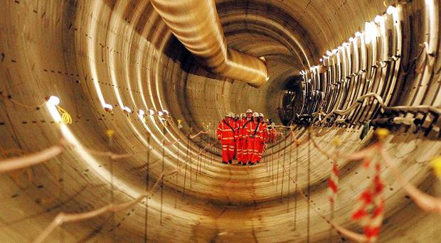 Crossrail workers inspecting the first completed section of Crossrail tunnel.