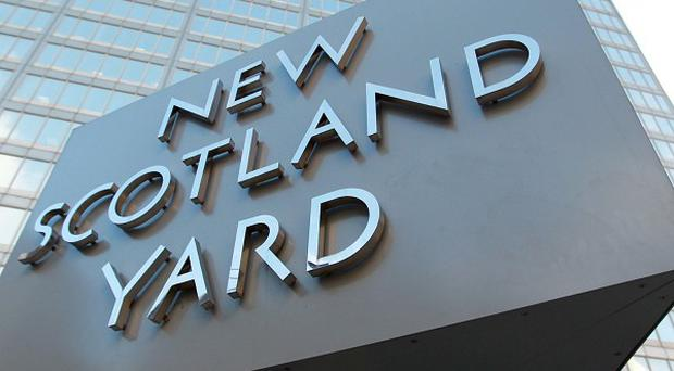 Scotland Yard said three officers from the Diplomatic Protection Service were arrested