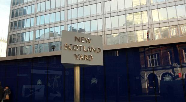 Scotland Yard said three officers from the Diplomatic Protection Group had been arrested