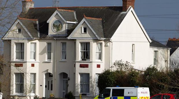 Police at houses in Thameside as properties were evacuated after two adults and a child fell ill