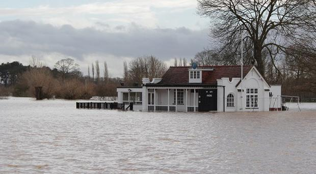 Worcester's cricket pavillion flooded in the the rising tide after the river Severn burst its banks
