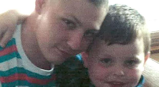 Dean Mayley (left), hugging his seven-year-old nephew Callum (PA/Metropolitan Police)