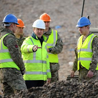 Prime Minister David Cameron meets members of 39 Engineers as he inspects work being carried out on Chesil Beach between Portland and Weymouth in Dorset.