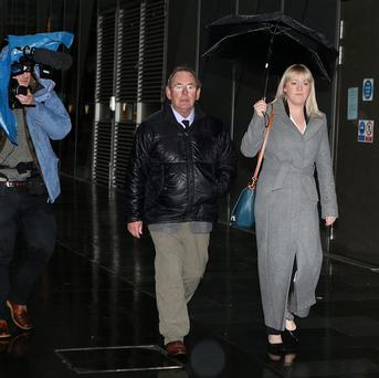 Fred Talbot arrives, with an unidentified woman, at Manchester Magistrates' Court.