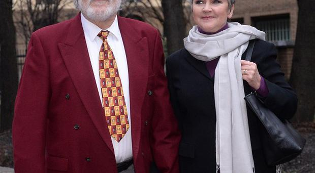 Former disc jockey Dave Lee Travis arrives at Southwark Crown Court with his wife Marianne