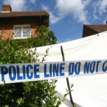 A man is being held after the bodies of two people were found at a house