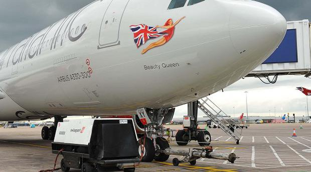 Two passengers were injured when a Virgin Atlantic flight to Florida was evacuated at Gatwick Airport