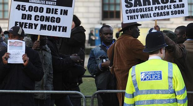 Demonstrators in London protest against genocide in the Democratic Republic of Congo.