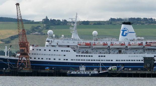 A passenger died when a freak wave hit the Marco Polo cruise ship in the English Channel