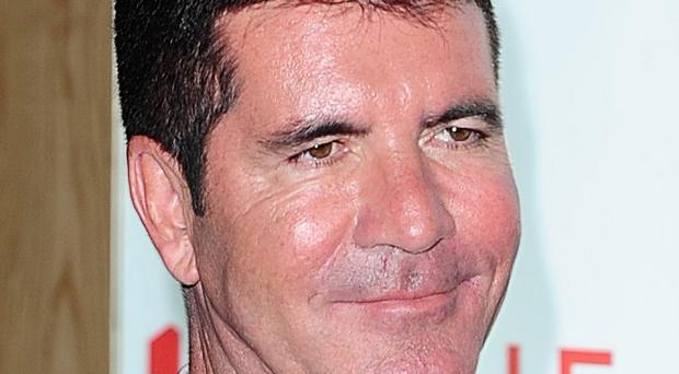 Simon Cowell and girlfriend Lauren Silverman have become parents of a son, Eric