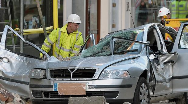 The scene in Kingsway, opposite Holborn Tube station, after minicab driver Julie Sillitoe was killed when masonry fell from the building