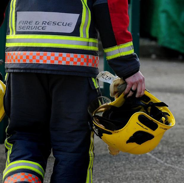 A firefighter has died while on duty in a flood-hit town