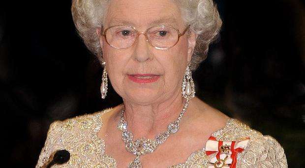 The Queen welcomed famous names such as John Hurt, Sir Roger Moore and Joan Collins to Buckingham Palce