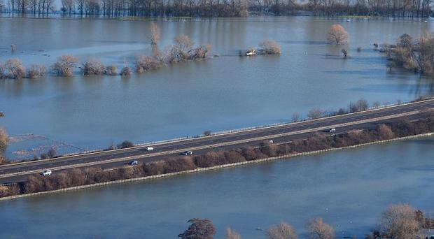 Flood water surrounds the M3 motorway near Chertsey, Surrey