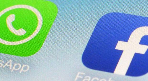 Facebook hopes that buying WhatsApp will help the instant messaging service reach a billion people (AP)
