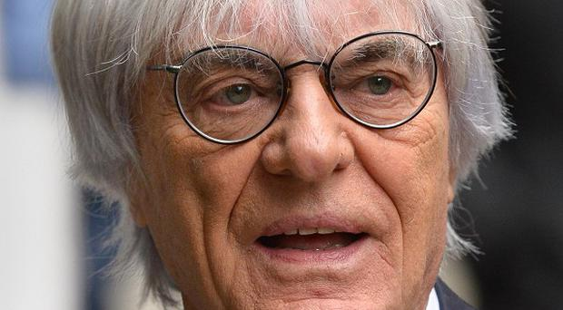 Bernie Ecclestone is waiting to hear whether he has won a multi-million pound High Court fight with a German media company