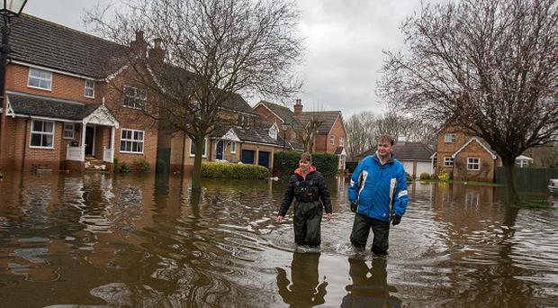 Some families in Surrey affected by this year's floods were assisted with food, clothing, new bedding and utilities using the emergency fund, the LGA said