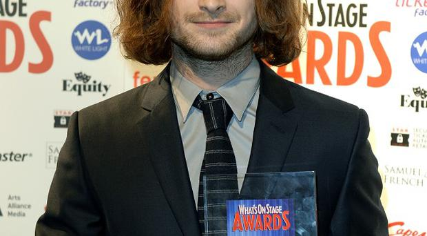 Daniel Radcliffe with the award for Best Actor in a Play during the What'sOnStage Awards at the Prince of Wales Theatre, London.