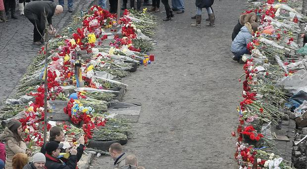 Flowers cover the ground where protesters were killed in a recent clash with riot police in Kiev's Independence Square (AP Photo/Efrem Lukatsky)