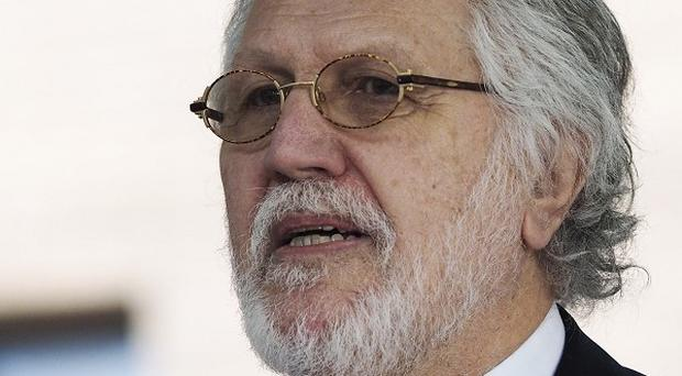 Prosecutors want Dave Lee Travis to face a retrial on charges of indecent and sexual assault, a court has heard.