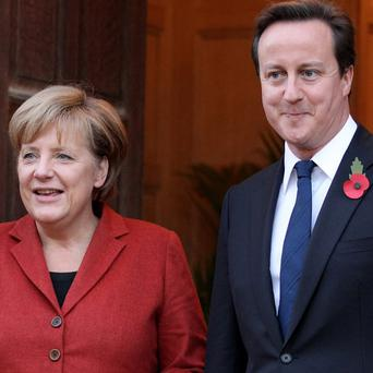 Prime Minister David Cameron will hold talks with German chancellor Angela Merkel