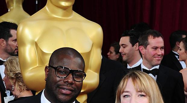 Steve McQueen and Bianca Stigter arriving at the 86th Academy Awards held at the Dolby Theatre in Hollywood