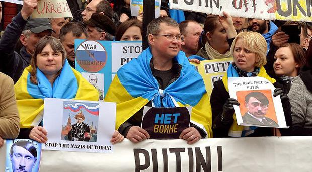 British-based Ukrainians gather outside the Russian embassy in London to protest against the build-up of troops in Crimea