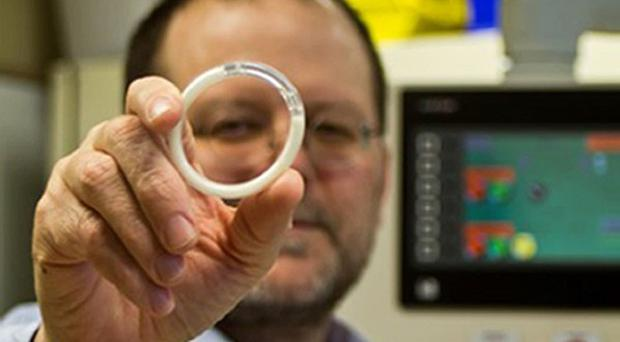 Patrick Kiser shows off a device he developed as a new contraceptive for women that protects against HIV as well as unwanted pregnancies