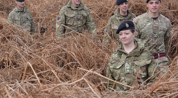 Soldiers led by Army reservist Captain Leanne Christmas march along the front line trench of a newly discovered First World War practice battlefield in Gosport, Hampshire
