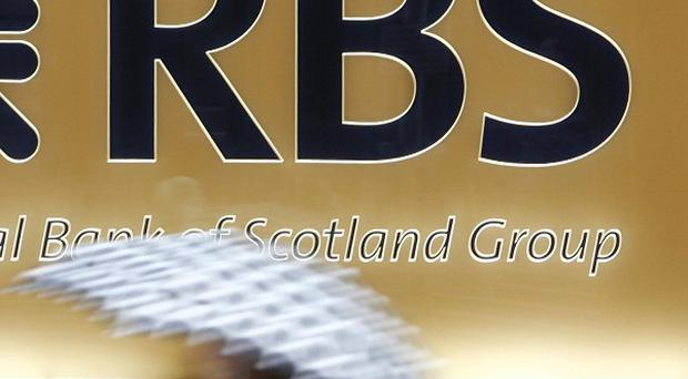 Royal Bank of Scotland has handed out shares worth up to £18.2 million for its top management