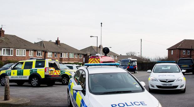 Emergency services at Chestnut Grove, Mexborough, near Doncaster, where a 55-year-old man has been arrested on suspicion of possessing explosives