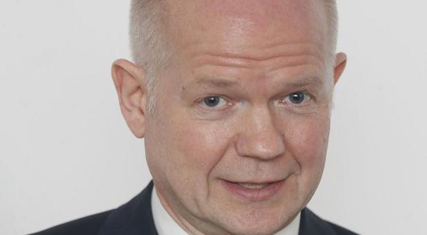 Foreign Secretary William Hague has warned Russia about the consequences of its actions in Crimea