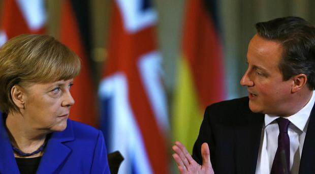 Prime Minister David Cameron and German Chancellor Angela Merkel have issued a warning to Russia over the Crimean region of Ukraine
