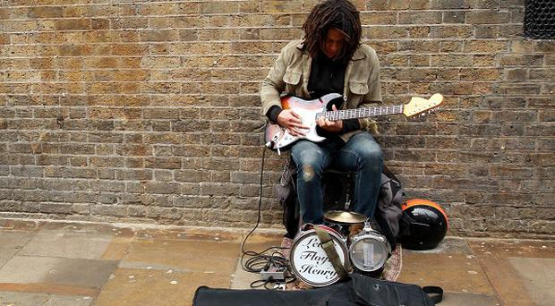 A judge has backed a council over new rules governing busking.