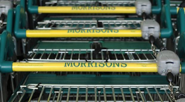 Morrisons has posted an annual loss of £176 million