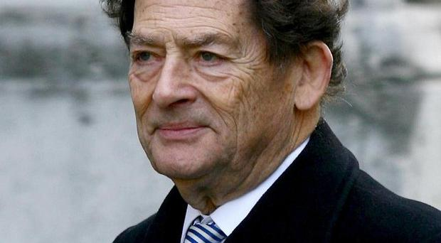 Lord Lawson said the Chancellor should use the March 19 statement to knock a penny off the basic rate of tax