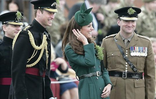 The Duke and Duchess of Cambridge during their visit to meet the Irish Guards at their military base in Aldershot